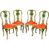 A Set Of Four Painted Yellow Arm Chairs