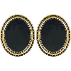 A Pair Of Irish Regency Oval Gilt And Ebonised Mirrors