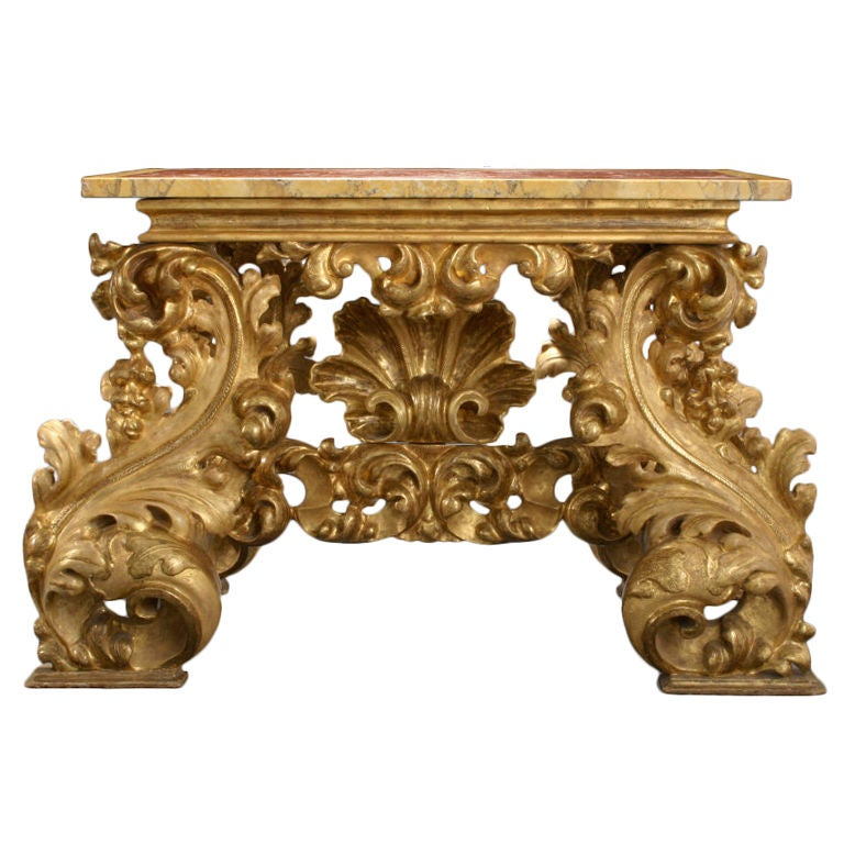 An italian baroque carved giltwood console table at 1stdibs for Plastic baroque furniture