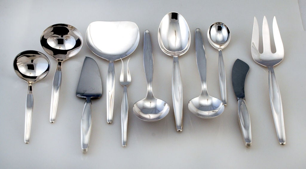PLEASE VISIT LAUREN STANLEY<br /> <br /> A large (101 place and serving pieces) and fine set of circa 1951 sterling silver flatware in the Contour pattern by Towle of Neeburyport, MA.  Contour was introduced in 1951. Contour has a soft and flowing