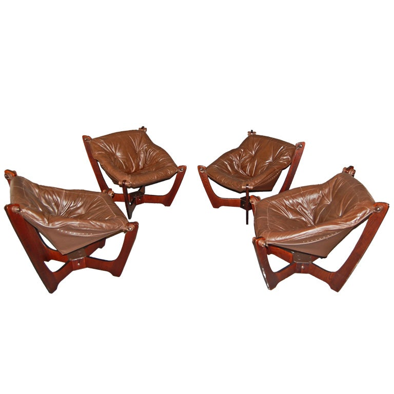 four mid century modern leather sling chairs is no longer available