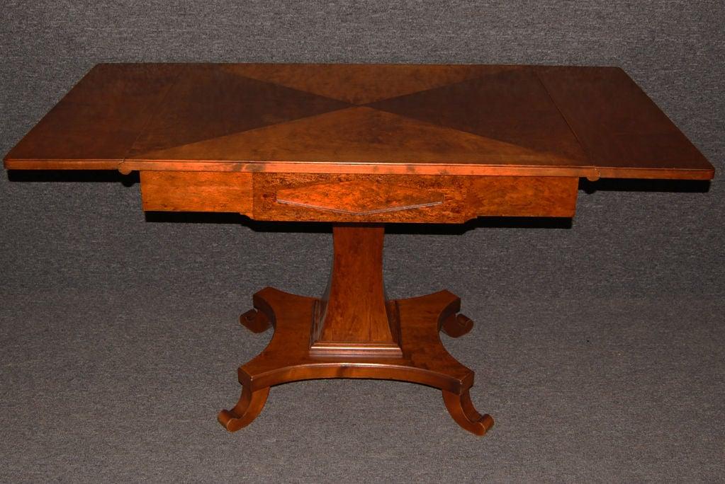 Karl Johan drop-leaf center table of flame birch and masurbjork (birch root burl) on gracefully shaped pedestal base.