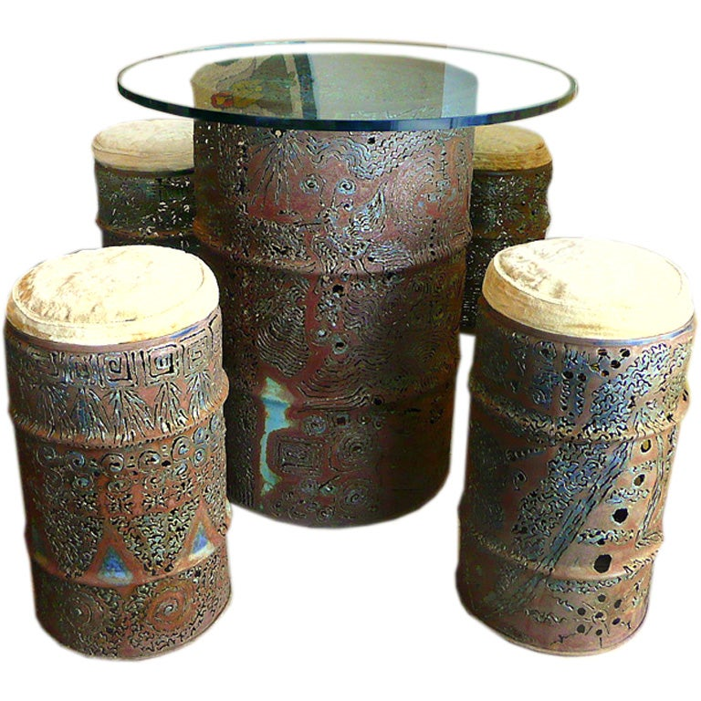 Torch Cut Metal Drum Table And Four Stools By Chuck