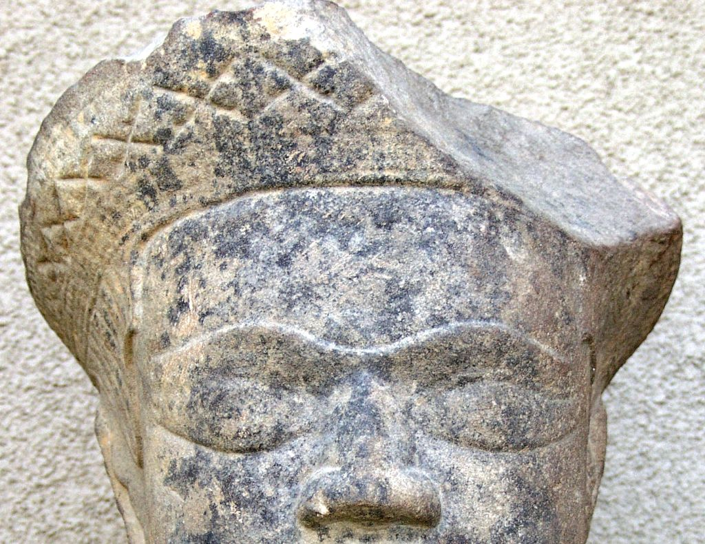 Early cambodian carved limestone head at stdibs