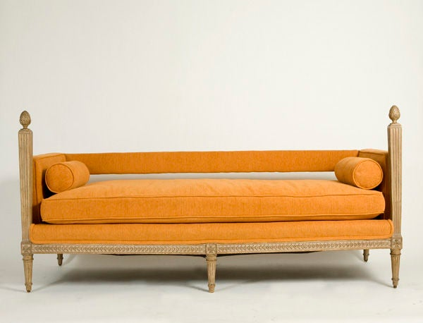 A diminutive XVI persimmon chenille upholstered sofa. Down filled cushions and bolsters throughout.<br />