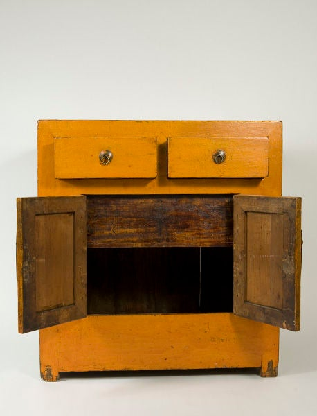 An orange lacquered Korean chest with brass hardware. Late 19th century to early 20th century. Maintains a wonderfully patinated waxed finish. From the estate of Bozu the Clown.