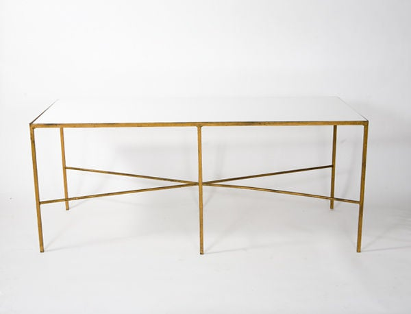 Minimalist mid-century gold painted steel table with beautiful white milk glass top.