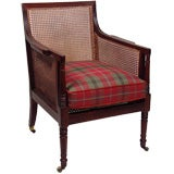 A Late Regency Mahogany and Caned Library Chair