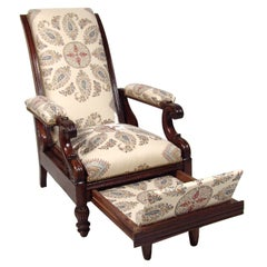 A Late Empire Armchair with Foot Rest and Paisley Fabric