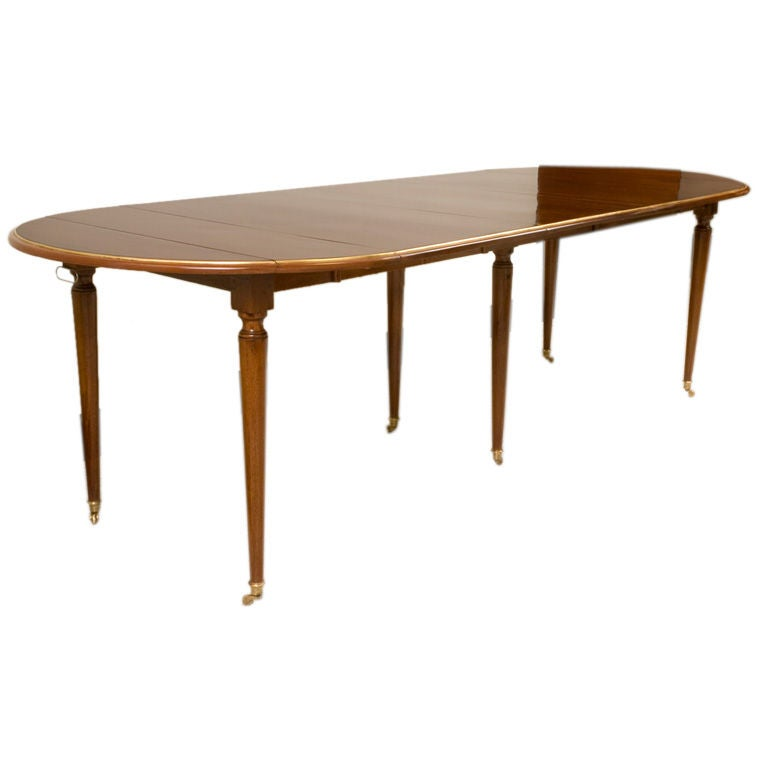 A directoire style mahogany dining table with brass trim for Dining room table 32 wide