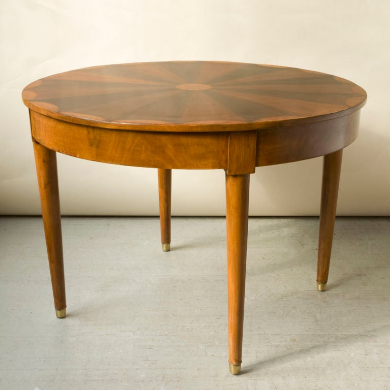 A Directoire style walnut, mahogany and bois clair round table at 1stdibs