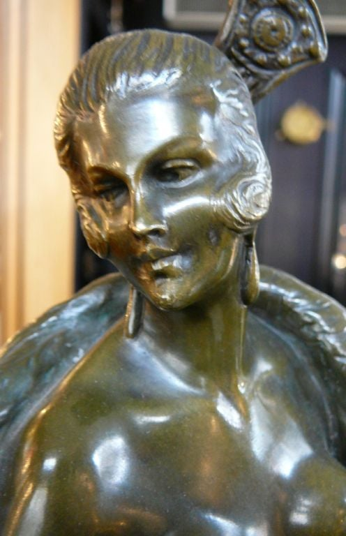 This typically erotic bronze is very indicative of Bruno Zach's unique style, and the female nude subject is modelled in gartered stockings and draped in a long fur coat, with intricate detail of the hair comb and earrings. The socle is signed ZACH
