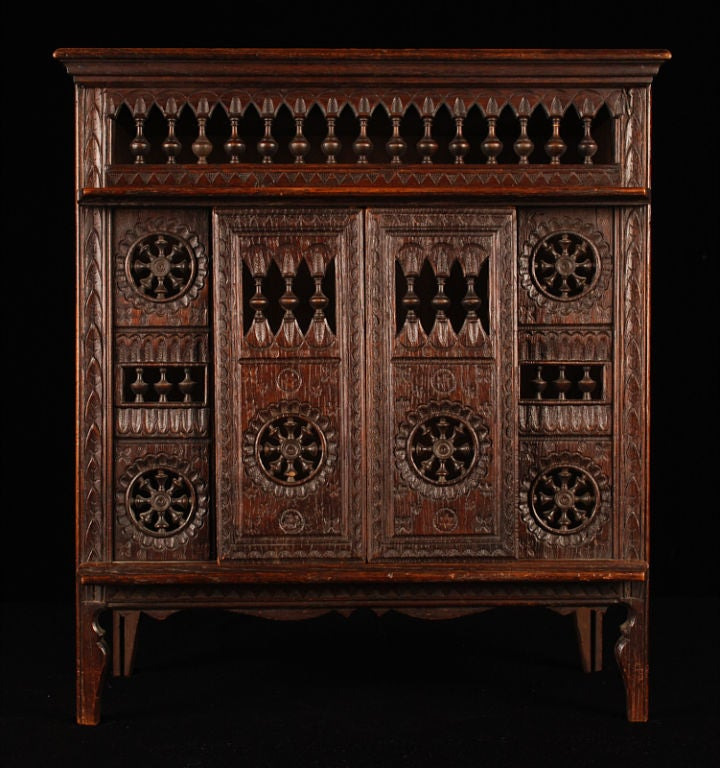 This another fine example of the splendid and petite vintage furniture from the Brittany region of France. Wonderfully carved in every detail, this miniature piece is of a Brittany Closed Bed also used as cupboard or for storage. The four front