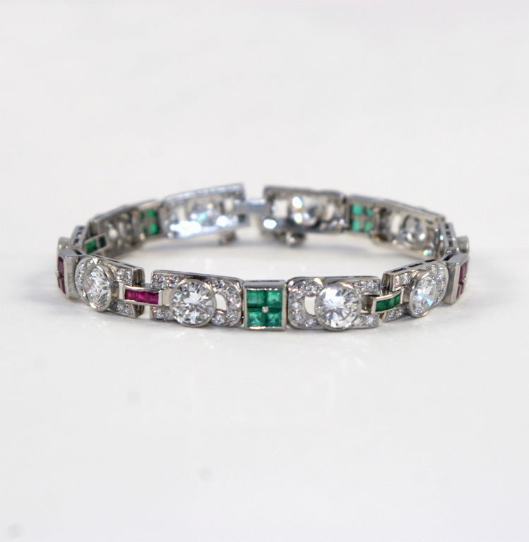 Sumptuous Platinum & Diamond Deco Bracelet made up of 10 Opposing Pave Diamond Segments,  each set with one Old Mine Diamond weighing over 1ct each. Each pave segment set with 9 stones. Total Pave weight: Approx. 3.75cts. Accented by 2 square