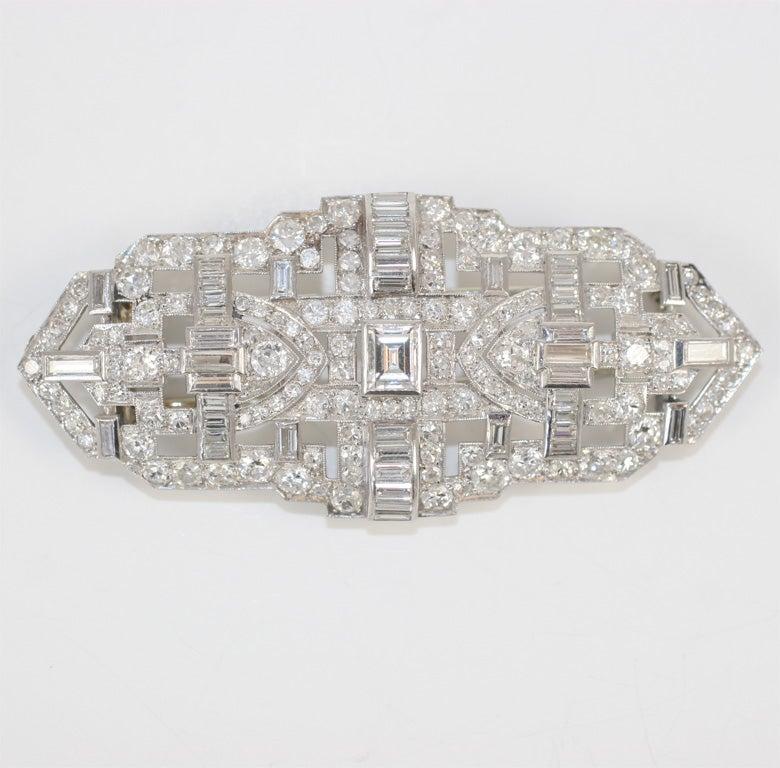 Machine Age Platinum Diamond Brooch<br /> center emerald cut diamond 1.00ct<br /> 10 carats round diamonds <br /> 2 carats baguette diamonds