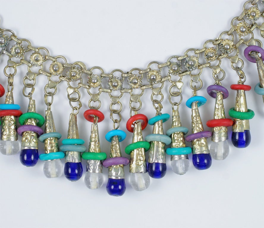 "Multi colored, silver tone necklace with twenty one 2"" beaded dangles. 24"" circumference."