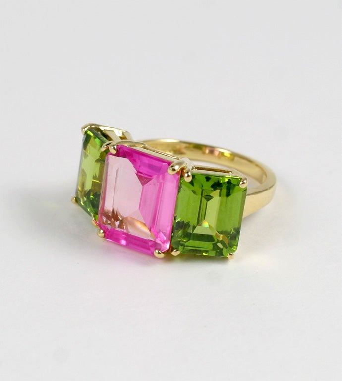 18kt yellow gold emerald cut ring with pink topaz and