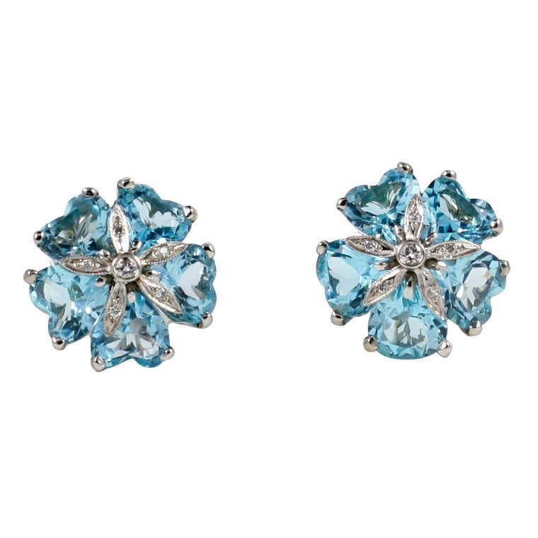 18kt White Gold Sand Dollar Earring with Blue Topaz and Diamonds