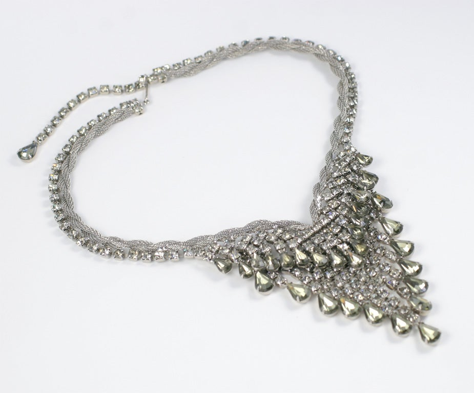 Prong set rhinestones attached to a twisted metal mesh rope necklace with matching earrings.  Minimum length is 15 1/2