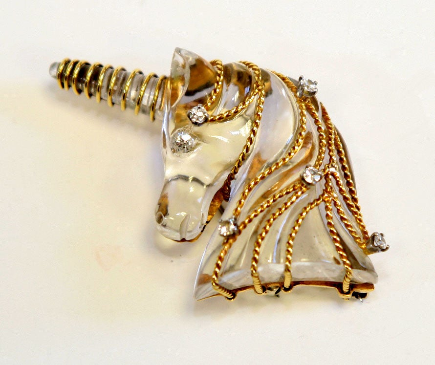 Carved crystal and 14k yellow gold wire unicorn brooch