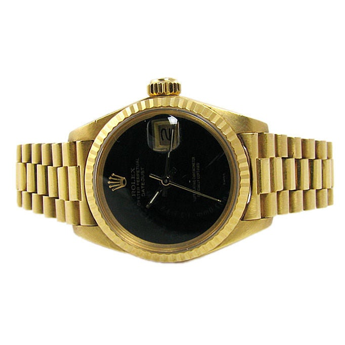 Rolex Ladies Gold Black Face Watch at 1stdibs