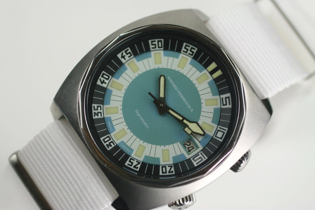 Vintage Girard-Perregaux Gyromatic Deep Diver. This has a crown for the inner rotating bezel. The dive watch is on a white nylon military strap.