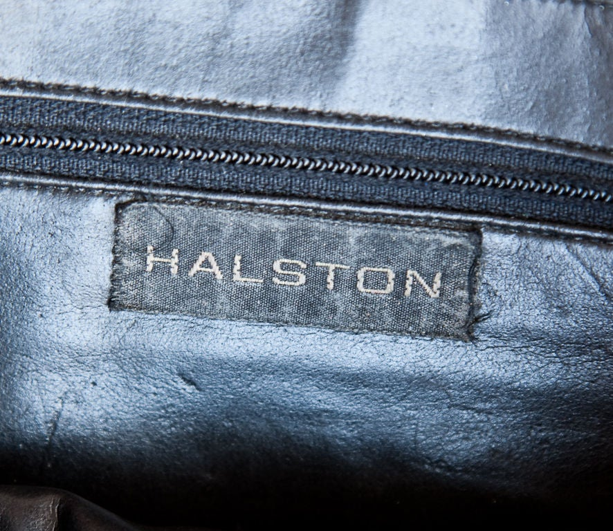 Halston pony skin bag with giraffe motif stencil.Purse has detachable black leather shoulder strap so it can be carried as a clutch.Bag has black leather interior and trim.