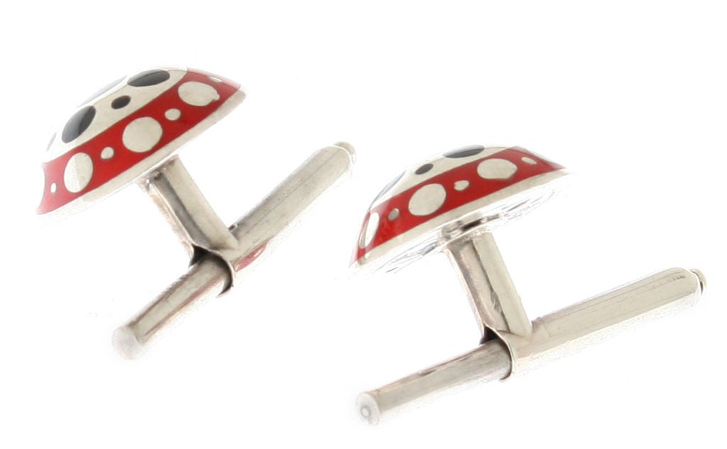 These are great looking cufflinks.  The fronts are domed and they have beautiful enamel work.