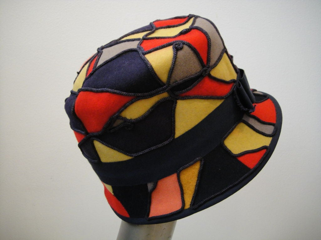 Adorable, sporty 60's Patchwork felt, Bucket style hat with couched cording in indigo blue, red, tan, and gray.  Indigo Blue grosgrain hat band. No makers tags.  2