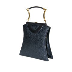 Shapely Textured Leather Handbag by Holiday