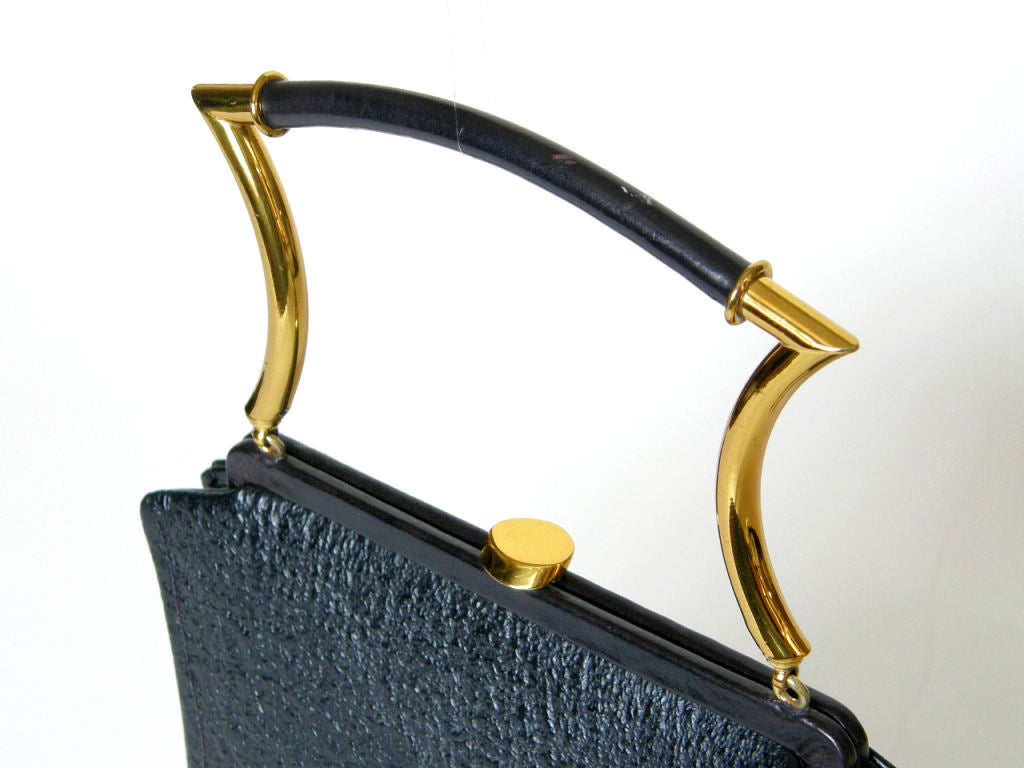 Shapely Textured Leather Handbag by Holiday 3
