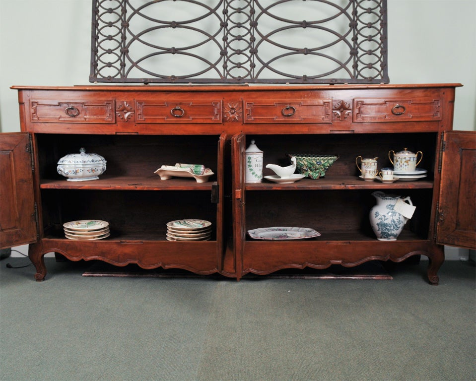 Fine French neoclassical sideboard in two original woods, wild cherry and elm. This impressive piece is uncharacteristically narrow in depth for its time period, escutcheons have been replaced, otherwise this piece is all original and originating