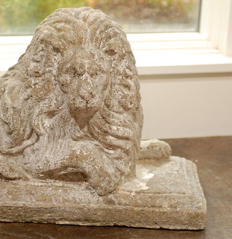 Pair of English Reclining Stone Lions on Bases from the Early 20th Century In Good Condition For Sale In Atlanta, GA