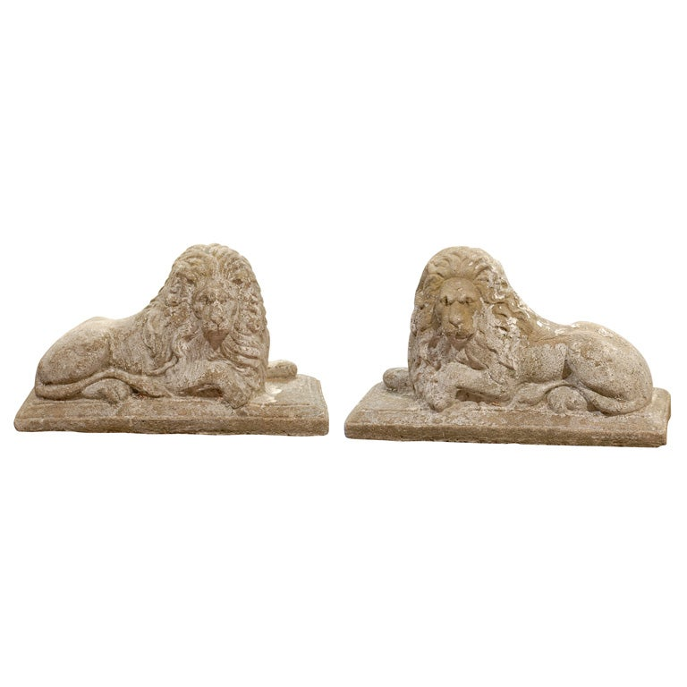 Pair of English Reclining Stone Lions on Bases from the Early 20th Century For Sale