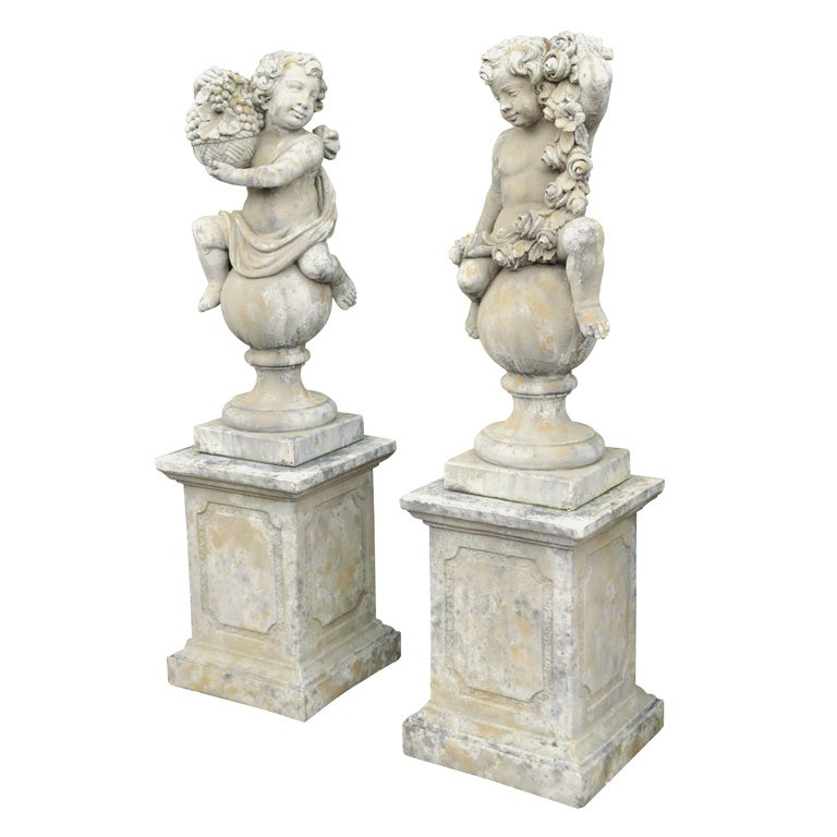 Pair of Stone Putti on Pedestals For Sale