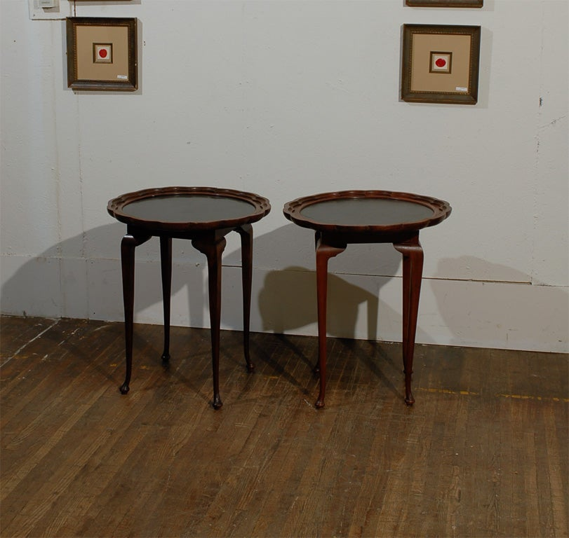 Italian wood side tables with pie-crust edge. Black stone top. Priced as a pair.  Visit our 1,500 + items website: www.swedishantiques.biz