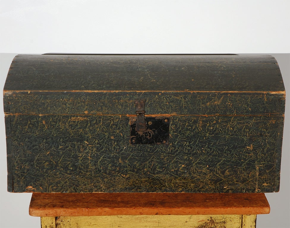 19th century original paint decorated hand made and dovetailed dome top box from Pennsylvania. This wonderful box has the original lock and latch on the front. It also is all dovetailed and cut nail construction. It is a wonderful blue/green sponge