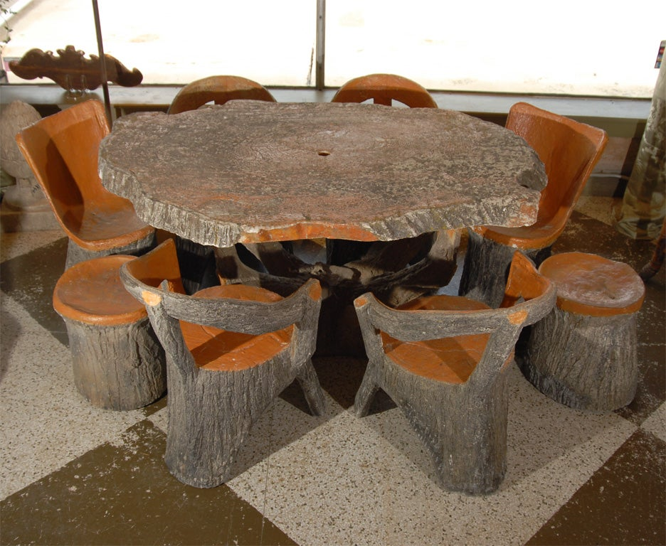 Cast Faux Bois Table With Four Armchairs , Two Armless Chairs and Two Stools. Has a Hole For an Umbrella