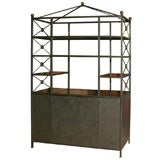 A Large Iron and Wood Etagere Cabinet