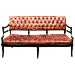 An Ebonized and Cognac Leather Tufted Settee