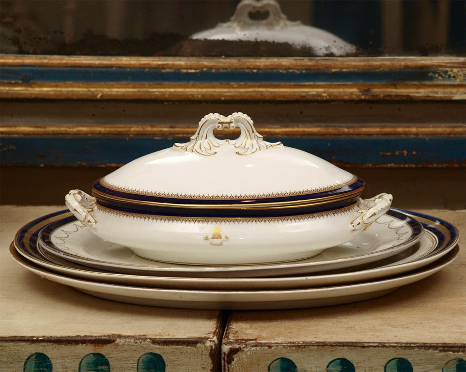 A large English dinner service with sufficient pieces for service for eight. The set includes two tureens with base platters, four covered dishes, covered sauce dish, nine soups, ten diners, eight salads, eight cream soup, 12 bread and butter, gravy