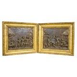 Pair of Gilt Framed Zinc Relief Panels