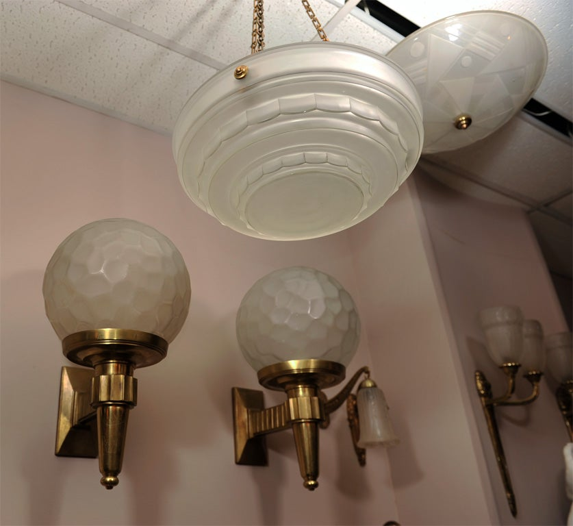 A French Art Deco lighting fixture by Sabino in clear and frosted glass, circa 1930s.