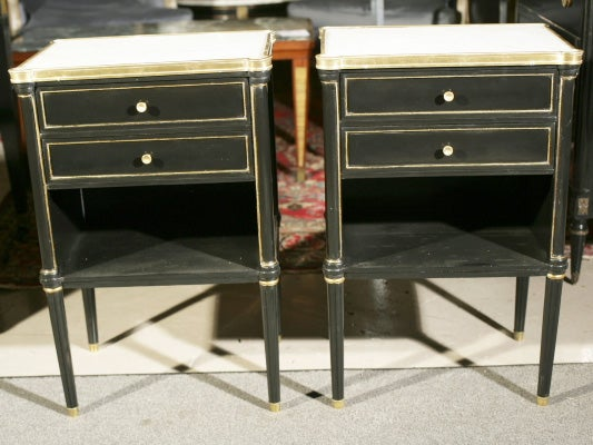 Pair fab nightstands with white marble top and bronze trim, with two narrow drawers over open-front cabinet, standing on four tapering legs and bronze caps. Stamped Jansen.