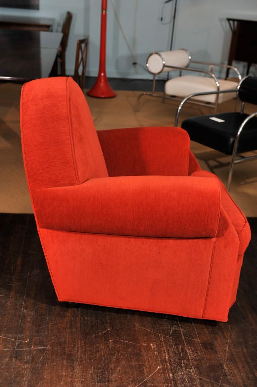 Sculptural club chair with dome shaped back, large rolled arms and balled feet. A really striking form, upholstered in rust colored fabric.