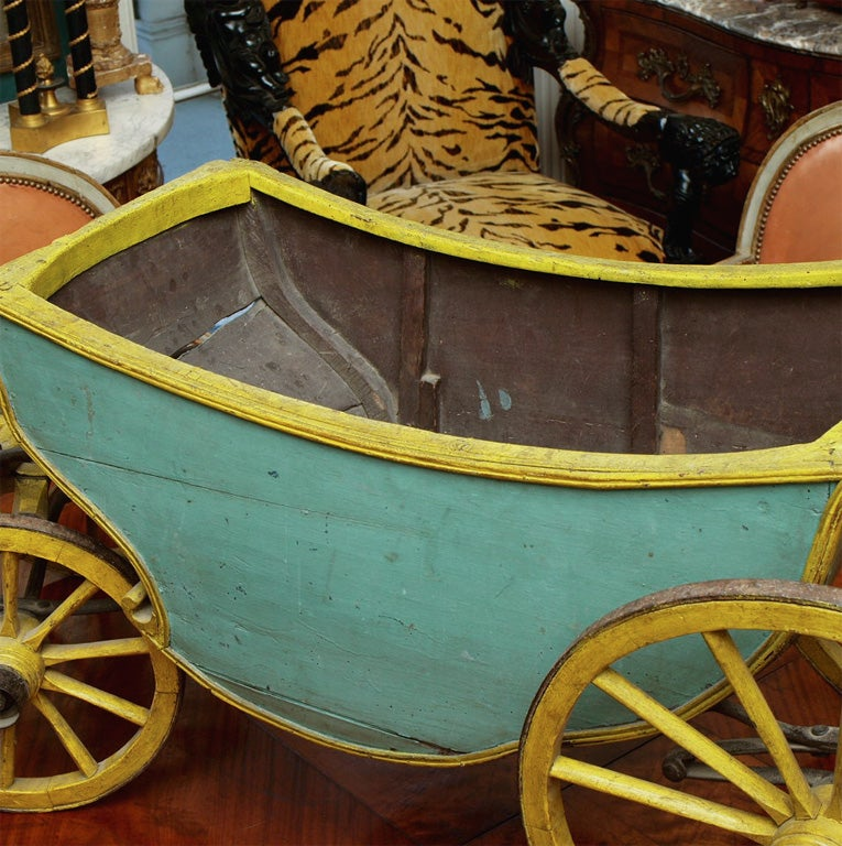 French 18th C Childs Cabriolet. This is the real thing. It is a working childs cabriolet that probably hooked to a smal goat to be pulled. It will make a great planter or just a sculptural object. MOST UNUSUAL, Paint is not original but very old and