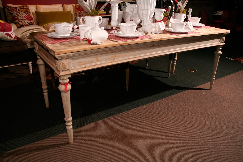 A Late 19th Century Painted Pine Plank Top Dining Table at