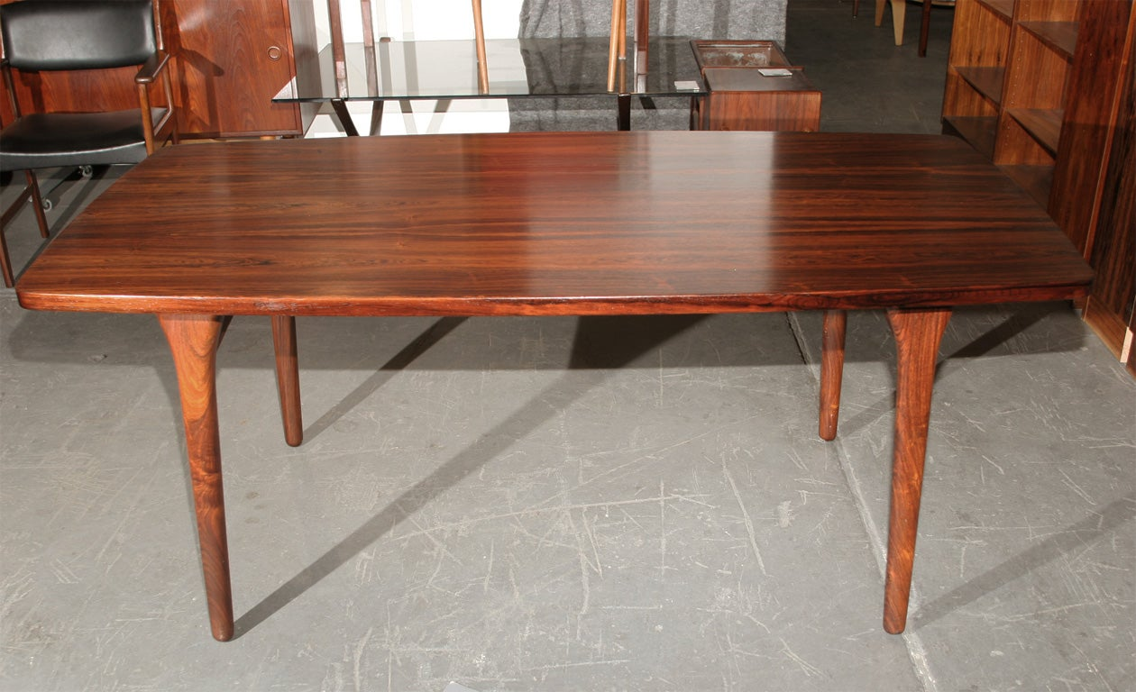 Bowed Rosewood Dining Table by Bruno Hansen at 1stdibs