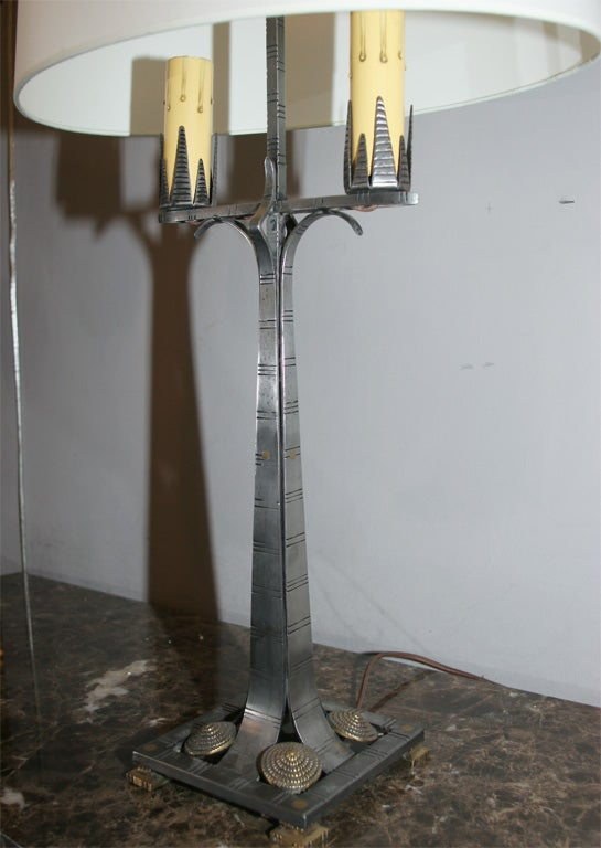 A pair of American Art Deco table lamps by Jules Bouy crafted of hammered iron and brass Shades not included