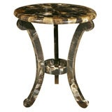 Horn-clad tripod table